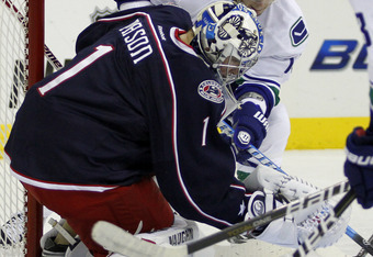 COLUMBUS, OH - OCTOBER 10:  Steve Mason #1 of the Columbus Blue Jackets makes s save on Alex Burrows #14 of the Vancouver Canucks during the game at Nationwide Arena on October 10, 2011 in Columbus, Ohio.  The Canucks defeated the Blue Jackets 3-2.  (Phot