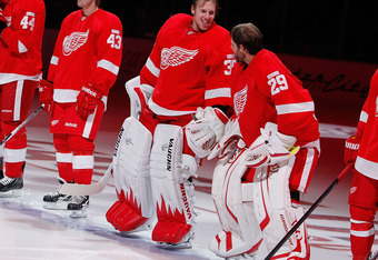 DETROIT, MI - OCTOBER 07:  Jimmy Howard #35 of the Detroit Red Wings talks with Ty Conklin #29 during introductions prior to playing the Ottawa Senators at Joe Louis Arena on October 7, 2011 in Detroit, Michigan. Detroit won the game 5-3. (Photo by Gregor