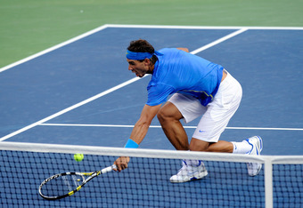 NEW YORK, NY - SEPTEMBER 12:  Rafael Nadal of Spain reaches for a return against Novak Djokovic of Serbia during the Men's Final on Day Fifteen of the 2011 US Open at the USTA Billie Jean King National Tennis Center on September 12, 2011 in the Flushing n