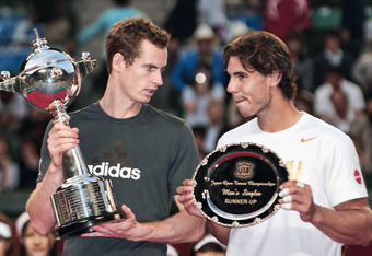 TOKYO, JAPAN - OCTOBER 09:  Andy Murray (L) of Great Britain talk to Rafael Nadal of Spain pose for photographers after the Men's Singles final during the day seven of the Rakuten Open at Ariake Colosseum on October 9, 2011 in Tokyo, Japan.  (Photo by Lin
