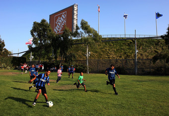 CARSON, CA - SEPTEMBER 10:  Children play soccer outside the stadium before the MLS match between D.C. United and Chivas USA at The Home Depot Center on September 10, 2011 in Carson, California.  (Photo by Jeff Golden/Getty Images)