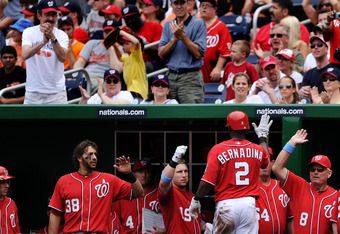 WASHINGTON, DC - JUNE 19: Roger Bernadina #2 of the Washington Nationals is greeted in the dugout after hits a solo home run against the Baltimore Orioles in the fifth inning at Nationals Park on June 19, 2011 in Washington, DC. The Baltimore Orioles won,