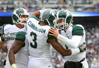 STATE COLLEGE, PA - NOVEMBER 27: Wide receiver B.J. Cunningham #3 celebrates his touchdown with quarterback Kirk Cousins #8 of the Michigan State Spartans during a game against the Penn State Nittany Lions on November 27, 2010 at Beaver Stadium in State C