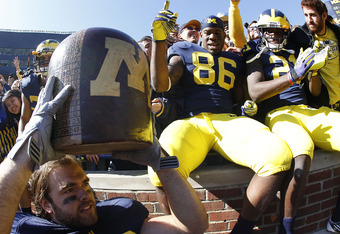 ANN ARBOR, MI - OCTOBER 01:  Ryan Van Bergen #53 of the Michigan Wolverines carries the 'Little Brown Jug' off the field after defeating the Minnesota Golden Gophers 58-0 at Michigan Stadium on October 1, 2011 in Ann Arbor, Michigan.  (Photo by Leon Halip
