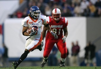 MEMPHIS,TN - DECEMBER 31:  Wide receiver Lawrence Bady #9 of the Boise State Broncos runs upfield against the Louisville Cardinals during the AutoZone Liberty bowl at the Liberty Bowl on December 31, 2004 in Memphis, Tennessee.  Louisville won 44-40.  (Ph