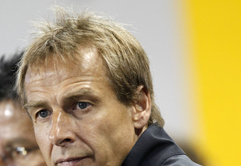 HARRISON, NJ - OCTOBER 11:  Jurgen Klinsmann, head coach of the United States, sits on the bench before a match against Ecuador at Red Bull Arena on October 11, 2011 in Harrison, New Jersey.  (Photo by Jeff Zelevansky/Getty Images)