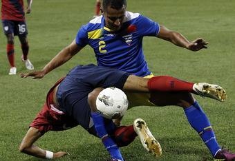 HARRISON, NJ - OCTOBER 11:  Danny Williams #7 of the United States tumbles over Eduardo Morante #2 of Ecuador during their match at Red Bull Arena on October 11, 2011 in Harrison, New Jersey.  (Photo by Jeff Zelevansky/Getty Images)