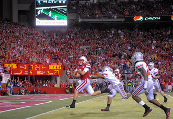 LINCOLN, NE - OCTOBER 8: Quarterback Taylor Martinez #3 of the Nebraska Cornhuskers scores a touchdown against the Ohio State Buckeyes during their game at Memorial Stadium October 8, 2011 in Lincoln, Nebraska. Nebraska Defeated Ohio State 34-27. (Photo b