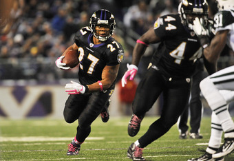 BALTIMORE - OCTOBER 2:  Ray Rice #27 of the Baltimore Ravens runs the ball against the New York Jets at M&T Bank Stadium on October 2. 2011 in Baltimore, Maryland. The Ravens defeated the Jets 34-17. (Photo by Larry French/Getty Images)