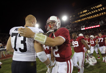 STANFORD, CA - OCTOBER 08:  Andrew Luck #12 of the Stanford Cardinal shakes hands with Ryan Miller #73 of the Colorado Buffaloes at Stanford Stadium on October 8, 2011 in Stanford, California.  (Photo by Ezra Shaw/Getty Images)