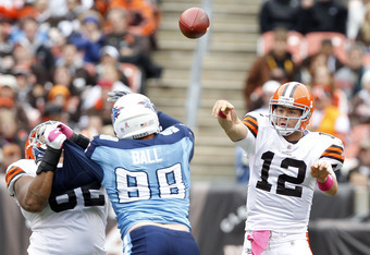 CLEVELAND, OH - OCTOBER 02:  Quarterback Colt McCoy #12 of the Cleveland Browns passes the ball over defensive end Dave Ball #98 of the Tennessee Titans at Cleveland Browns Stadium on October 2, 2011 in Cleveland, Ohio.  (Photo by Matt Sullivan/Getty Imag