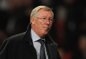 MANCHESTER, ENGLAND - SEPTEMBER 27:  Sir Alex Ferguson of Manchester United looks thoughtful after the UEFA Champions League Group C match between Manchester United and FC Basel at Old Trafford on September 27, 2011 in Manchester, England.  (Photo by Mich