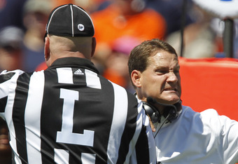 AUBURN, AL - SEPTEMBER 10:  Coach Gene Chizik of the Auburn Tigers reacts to the referee during a game against the Mississippi State Bulldogs in the first quarter on September 10, 2011 at Jordan-Hare Stadium in Auburn, Alabama. (Photo by Butch Dill/Getty