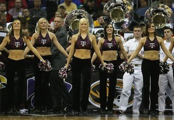 KANSAS CITY, MO - MARCH 13:  Texas A&M Aggies cheerleaders perform during the game against the Iowa State Cyclones during day 1 of the Big 12 Men's Basketball Tournament on March 13, 2008 at the Sprint Center in Kansas City, Missouri. (Photo by Jamie Squi