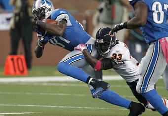 DETROIT, MI - OCTOBER 10:  Calvin Johnson #81 of the Detroit Lions tries to break a tackle by  Charles Tillman #33 of the Chicago Bears after a second quarter catch at Ford Field on October 10, 2011 in Detroit, Michigan.  (Photo by Gregory Shamus/Getty Im