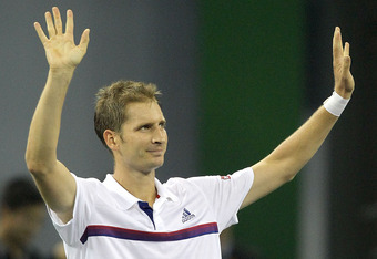 SHANGHAI, CHINA - OCTOBER 13:  Florian Mayer of Germany acknowledges the crowd after his win over Rafael Nadal of Spain during the Shanghai Rolex Masters at the Qi Zhong Tennis Center on October 13, 2011 in Shanghai, China.  (Photo by Matthew Stockman/Get