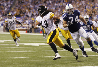 INDIANAPOLIS, IN - SEPTEMBER 25: Troy Polamalu #43 of the Pittsburgh Steelers returns a fumble 16 yards for a touchdown in the fourth quarter against the Indianapolis Colts at Lucas Oil Stadium on September 25, 2011 in Indianapolis, Indiana. The Steelers