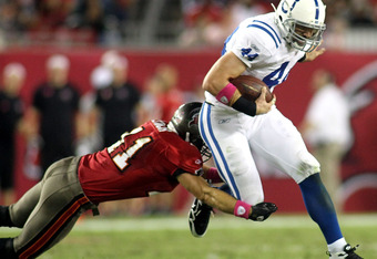 TAMPA, FL - OCTOBER 03: Tight end Dallas Clark #44 of the Indianapolis Colts runs the ball against Safety Sean Jones #26 of the Tampa Bay Buccaneers at Raymond James Stadium on October 3, 2011 in Tampa, Florida. (Photo by Marc Serota/Getty Images)