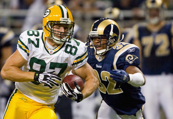 ST. LOUIS, MO - SEPTEMBER 27: Jordy Nelson #87 of the Green Bay Packers makes a catch against Bradley Fletcher #32 of the St. Louis Rams at the Edward Jones Dome on September 27, 2009 in St. Louis, Missouri.  The Packers beat the Rams 36-17.  (Photo by Di