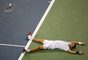 NEW YORK - SEPTEMBER 12:  Novak Djokovic of Serbia reacts after he won match point against Rafael Nadal of Spain during the Men's Final on Day Fifteen of the 2011 US Open at the USTA Billie Jean King National Tennis Center on September 12, 2011 in the Flu