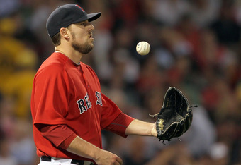 BOSTON, MA  - JUNE 17:  John Lackey #41 of the Boston Red Sox reacts in the third inning against the Milwaukee Brewers at Fenway Park on June 17, 2011 in Boston, Massachusetts.  (Photo by Jim Rogash/Getty Images)