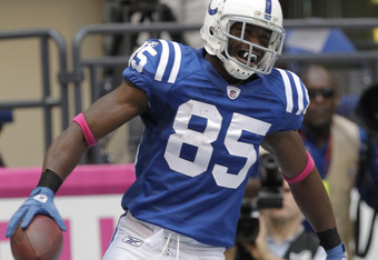 INDIANAPOLIS, IN - OCTOBER 9: Pierre Garcon, #85 of the Indianapolis Colts  celebrates after making a touchdown catch against the Kansas City Chiefs at Lucas Oil Field on October 9, 2011 in Indianapolis, Indiana. The Chiefs won 28-24.  (Photo by John Somm
