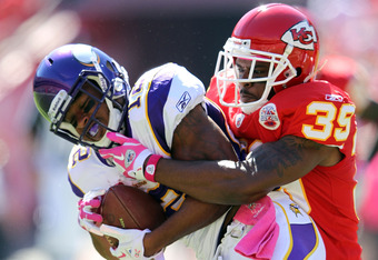 KANSAS CITY, MO - OCTOBER 02:  Receiver Percy Harvin #12 of the Minnesota Vikings is tackled by Brandon Carr #39 of the Kansas City Chiefs during the game on October 2, 2011 at Arrowhead Stadium in Kansas City, Missouri.  (Photo by Jamie Squire/Getty Imag