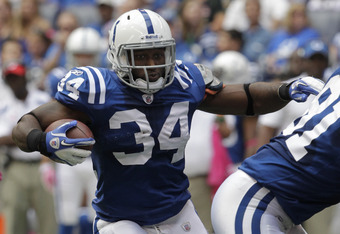 INDIANAPOLIS, IN - OCTOBER 9: Delone Carter #34, of the Indianapolis Colts  runs against the Kansas City Chiefs during the first half of play at Lucas Oil Field on October 9, 2011 in Indianapolis, Indiana. The Chiefs won 28-24.  (Photo by John Sommers II/