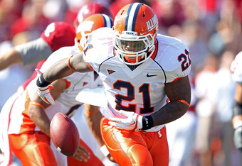 BLOOMINGTON, IN - OCTOBER 08:  Jason Ford #21 of the Illinois Illini  fumbles the ball during the game against the Indiana Hoosiers at Memorial Stadium on October 8, 2011 in Bloomington, Indiana.  Illinois won 41-20.  (Photo by Andy Lyons/Getty Images)