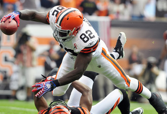 CLEVELAND, OH - SEPTEMBER 11: Tight end Benjamin Watson #82 of the Cleveland Browns reaches for a touchdown over cornerback  Leon Hall #29 of the Cincinnati Bengals during the second quarter during a season opener at Cleveland Browns Stadium on September