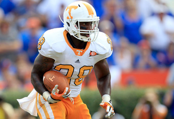 GAINESVILLE, FL - SEPTEMBER 17:  Running back Tauren Poole #28 of the Tennessee Volunteers during a game against the Florida Gators  at Ben Hill Griffin Stadium on September 17, 2011 in Gainesville, Florida.  (Photo by Sam Greenwood/Getty Images)