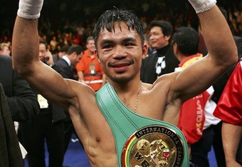 LAS VEGAS - JANUARY 21:  Manny Pacquiao of the Phillippines celebrates after knocking out Erik Morales of Mexico in the 10th round during their Super Featherweight Championship fight at Thomas & Mack Arena on January 21, 2006 in Las Vegas, Nevada.  (Photo