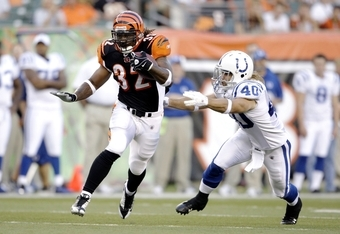 CINCINNATI, OH - AUGUST 3:  Cedric Benson #32 of the Cincinnati Bengals runs away from Jamie Silva #40 of the Indianapolis Colts during the preseason game on August 3, 2009 at Paul Brown Stadium in Cincinnati, Ohio.  (Photo by Andy Lyons/Getty Images)