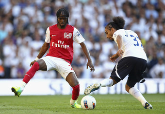 LONDON, ENGLAND - OCTOBER 02:  Gervinho of Arsenal closes down Benoit Assou Ekotto of Tottenham Hotspur during the Barclays Premier League match between Tottenham Hotspur and Arsenal at White Hart Lane on October 2, 2011 in London, England.  (Photo by Jul
