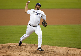 SAN DIEGO, CA - SEPTEMBER 24: Closing Pitcher Heath Bell #21 of the San Diego Padres throws the ball on his way to recording his 42nd save of the season during the ninth inning of the game against the Los Angeles Dodgers at Petco Park on September 24, 201