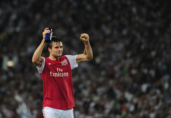 UDINE, ITALY - AUGUST 24:  Carl Jenkinson of Arsenal celerates victory during the UEFA Champions League play-off second leg match between Udinese Calcio and Arsenal FC at the Stadio Friuli on August 24, 2011 in Udine, Italy.  (Photo by Jamie McDonald/Gett