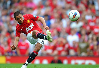 MANCHESTER, ENGLAND - OCTOBER 01: Javier Hernandez of Manchester United shoots at goal during the Barclays Premier League match between Manchester United and Norwich City at Old Trafford on October 1, 2011 in Manchester, England.  (Photo by Laurence Griff