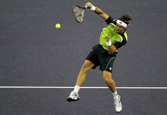 SHANGHAI, CHINA - OCTOBER 15:  David Ferrer of Spain hits an overhead while playing Feliciano Lopez of Spain during the semifinals of the Shanghai Rolex Masters at the Qi Zhong Tennis Center on October 15, 2011 in Shanghai, China.  (Photo by Matthew Stock