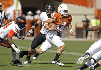 AUSTIN, TX - OCTOBER 15: Quarterback David Ash #14 of the Texas Longhorns scrambles in the first quarter against the Oklahoma State University Cowboys on October 15, 2011 at Darrell K. Royal-Texas Memorial Stadium in Austin, Texas.  (Photo by Erich Schleg