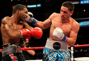LOS ANGELES, CA - OCTOBER 15:  Danny Garcia (R) lands a punch on Kendall Holt in their junior welterweight fight at Staples Center on October 15, 2011 in Los Angeles, California. Garcia won in a decision.   (Photo by Stephen Dunn/Getty Images)