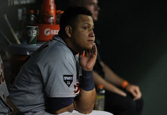 ARLINGTON, TX - OCTOBER 15:  Miguel Cabrera #24 of the Detroit Tigers sits on the bench during Game Six of the American League Championship Series against the Texas Rangers at Rangers Ballpark in Arlington on October 15, 2011 in Arlington, Texas.  (Photo