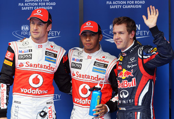YEONGAM-GUN, SOUTH KOREA - OCTOBER 15:  Pole sitter Lewis Hamilton (C) of Great Britain and McLaren is joined by second placed Sebastian Vettel (R) of Germany and Red Bull Racing and third placed Jenson Button (L) of Great Britain and McLaren in parc ferm