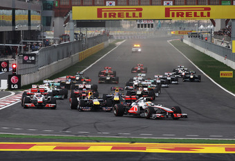 YEONGAM-GUN, SOUTH KOREA - OCTOBER 16:  Lewis Hamilton of Great Britain and McLaren leads the fied into the first corner on the first lap of the Korean Formula One Grand Prix at the Korea International Circuit on October 16, 2011 in Yeongam-gun, South Kor
