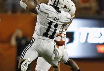 AUSTIN, TX - SEPTEMBER 10:  Cornerback Quandre Diggs #28 of the Texas Longhorns makes a fourth quarter interception over wide receiver Ross Apo #11of the BYU Cougars on September 10, 2011 at Darrell K. Royal-Texas Memorial Stadium in Austin, Texas.  The i
