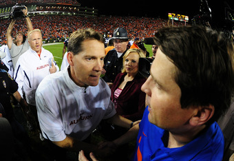 Gene Chizik meets with Will Muschamp after victory