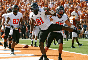 AUSTIN, TX - OCTOBER 15:  Wide receivers Justin Blackmon #81 and Josh Cooper #25 of the Oklahoma State University Cowboys celebrate a second quarter touchdown against the University of Texas Longhorns on October 15, 2011 at Darrell K. Royal-Texas Memorial
