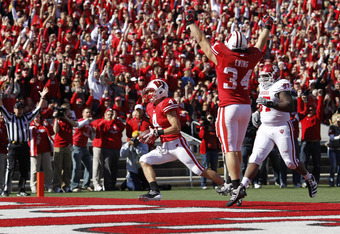 MADISON, WI - OCTOBER 15: Jared Abbrederis #4 of the Wisconsin Badgers returns a punt 38 yards for a touchdown in the third quarter against the Indiana Hoosiers at Camp Randall Stadium on October 15, 2011 in Madison, Wisconsin. The Badgers won 59-7. (Phot