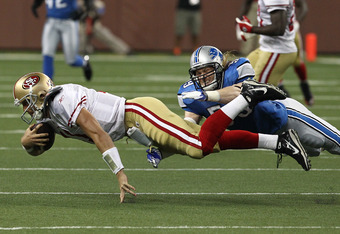 DETROIT, MI - OCTOBER 16:  Bobby Carpenter #59 of the Detroit Lions dives to tackle Alex Smith #11 of the San Francisco 49ers during a NFL game against the  at Ford Field on October 16, 2011 in Detroit, Michigan. The 49ers won 29-15 (Photo by Dave Reginek