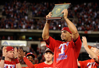 ARLINGTON, TX - OCTOBER 15:  Nelson Cruz #17 of the Texas Rangers holds the AL championship series Most Valuable Player Award after defeating the Detroit Tigers in Game Six of the American League Championship Series 15-5 to advance to the World Series at