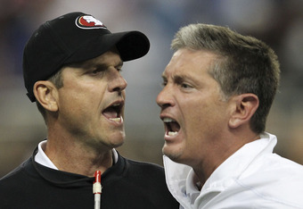 DETROIT - OCTOBER 16:  Jim Harbaugh head coach of the San Francisco 49ers argues with Jim Schwartz of the Detroit Lions during the NFL game at Ford Field on October 16, 2011 in Detroit, Michigan. The 49ers defeated the Lions 25-19.  (Photo by Leon Halip/G